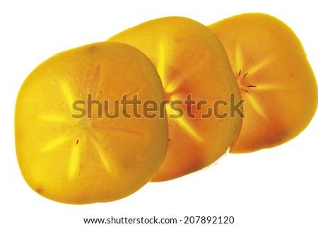 Three slices of kaki fruit in a row - stock photo