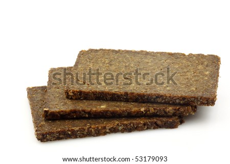 three slices of traditional dutch rye bread on a white background - stock photo