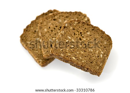 three slices of whole grain brown bread from above, shallow depth of field, isolated on white