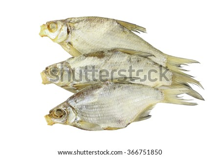 Three small dried fish for beer isolated on white - stock photo