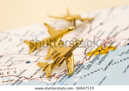 Three Small Golden Planes Over California. - stock photo