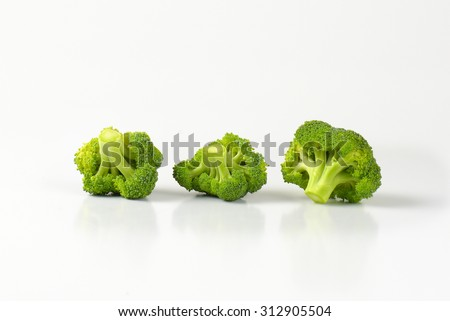 three small pieces of bright green fresh broccoli - stock photo