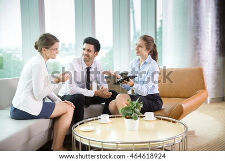 Three Smiling Business People at Informal Meeting