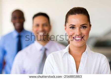 three smiling businesspeople standing in a row