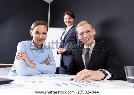 Three smiling colleagues in work - stock photo