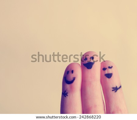 three smiling fingers that are very happy to be friends  - stock photo