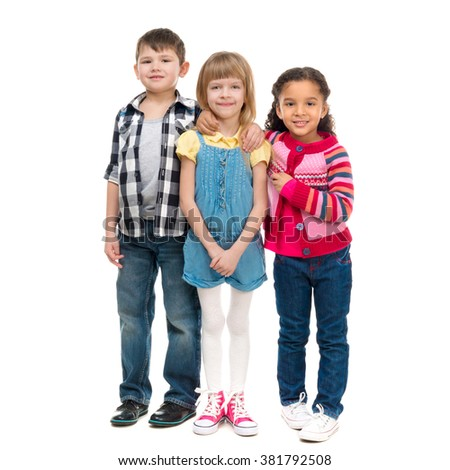 three smiling little children standing together isolated on white background - stock photo
