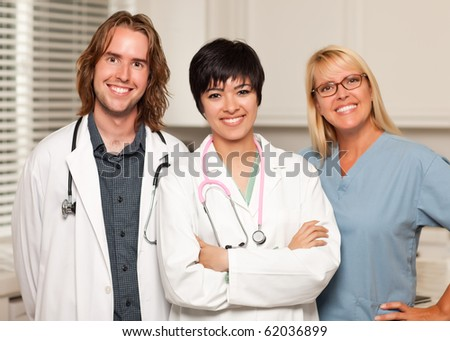 Three Smiling Male and Female Doctors or Nurses in the Office.