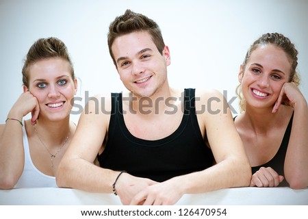 Three Smiling Persons after Fitness Exercises,Italy - stock photo