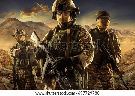 Three soldiers of russian mechanized infantry in desert of middle east