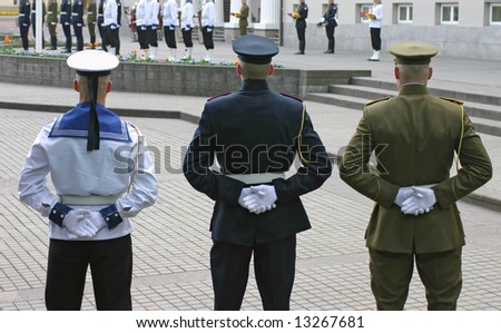 Three soldiers stand guard at lithuanian national flag ceremony