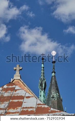 Three Spires With Different Crosses