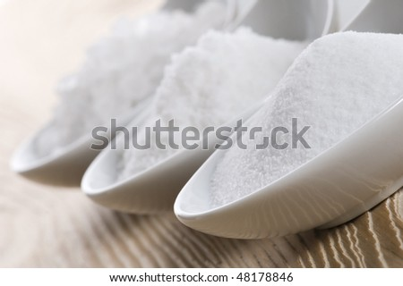 three spoons with different salt - stock photo