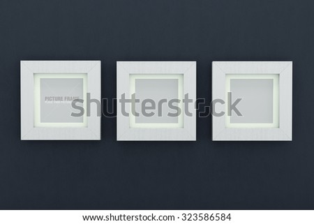 Three square size of white wooden picture frames on light navy blue wall