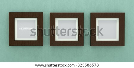 Three square size of wooden picture frames on light green concrete wall - stock photo