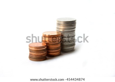 Three stack coins on white background.