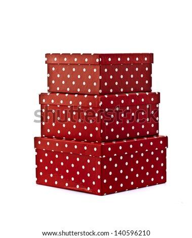 Three stack of red poka dot gift box on the white background - stock photo