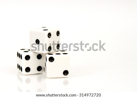 Three stacked die isolated on white background.