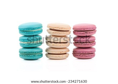 Three stackes of multicolored macaroons isolated on white background - stock photo
