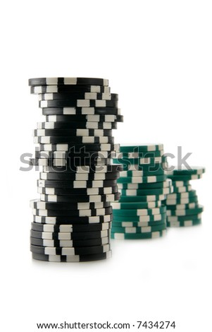 Three stacks of casino chips isolated over a white background. Focus on the first stack.