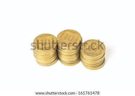 Three stacks of coins Israeli ten agorot isolated on white background - stock photo