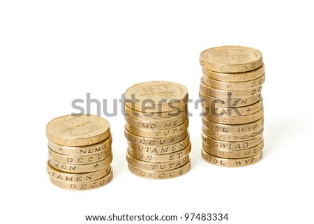 Three stacks of coins on an isolated background - stock photo