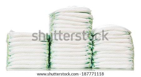 Three stacks of diapers isolated on white background - stock photo