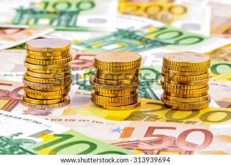 three stacks of money coins photo icon for financial planning, investments and interest income - stock photo