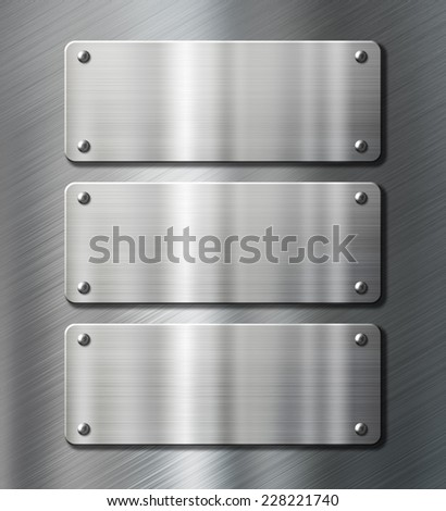 three stainless steel metal plates over black background - stock photo