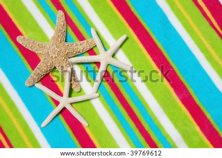 three starfish on pretty beach towel room for your text