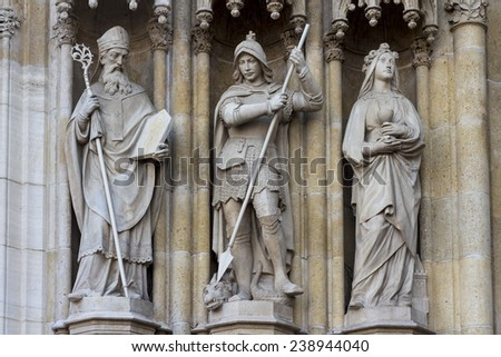 Three statues, detail of the portal of the gothic cathedral dedicated to the Assumption of Mary and to kings Saint Stephen and Saint Ladislaus in Zagreb, Croatia - stock photo