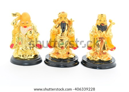 Three statues of Chinese gods of good fortune on a white background