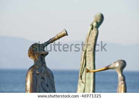 Three statues on boardwalk (malecon) Puerto Vallarta, Mexico - stock photo