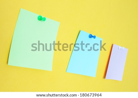 Three stickers on a yellow background
