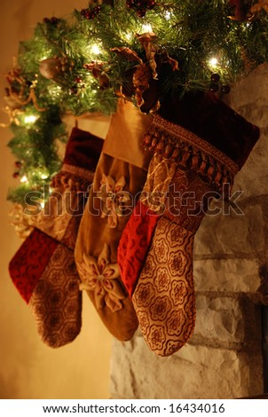 Three stockings hanging on the fireplace - stock photo