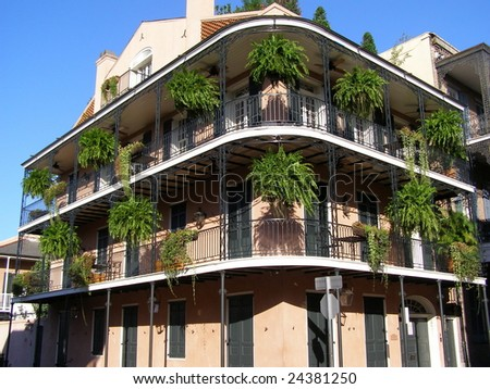 Three story apartment building with wrought iron balcony in the historic French Quarter in New Orleans, Louisiana - stock photo
