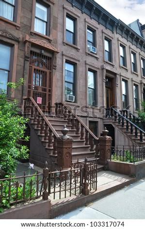 Three Story Tall Brownstone Homes Steps Urban Residential Neighborhood Brooklyn New York - stock photo