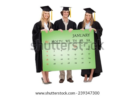 Three students in graduate robe holding a blank sign against green card - stock photo