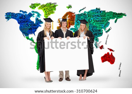 Three students in graduate robe holding a blank sign against white background with vignette - stock photo