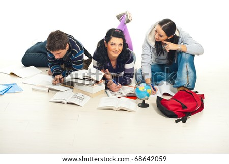 Three students learning together and doing their homework home