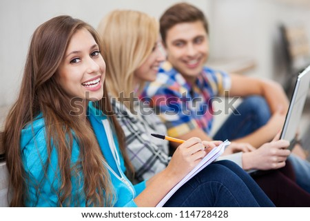 Three students smiling - stock photo