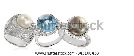 Three style of diamond and pearl rings, isolated on white. - stock photo