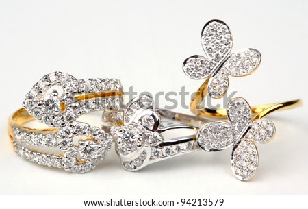 Three style of golden rings with diamond isolated on white background. - stock photo