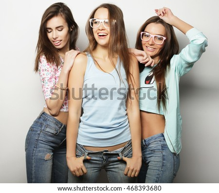 Three stylish sexy hipster girls best friends. Over white background.