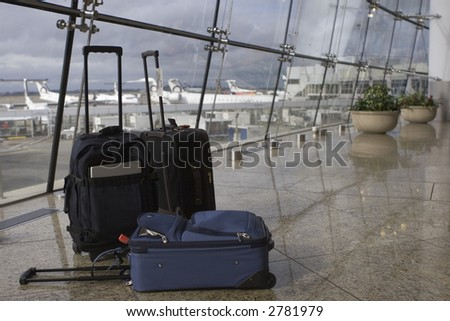 Three suitcases at Seatac airport in Seattle - stock photo