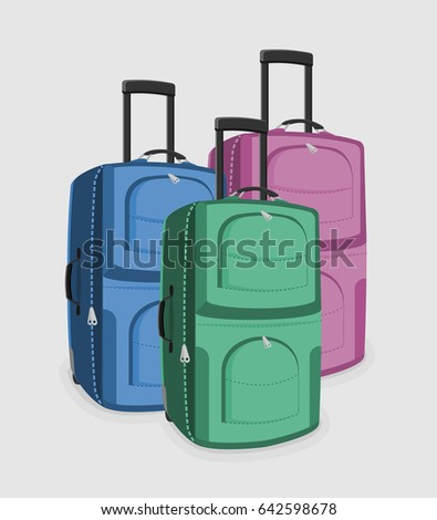 Three suitcases of green, pink and blue color isolated on a white background.