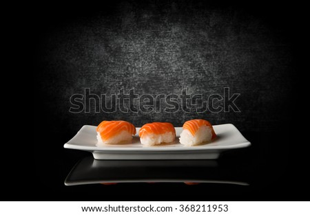 Three sushi on black