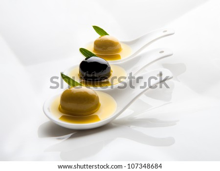 three tablespoons olive tasting with three - stock photo