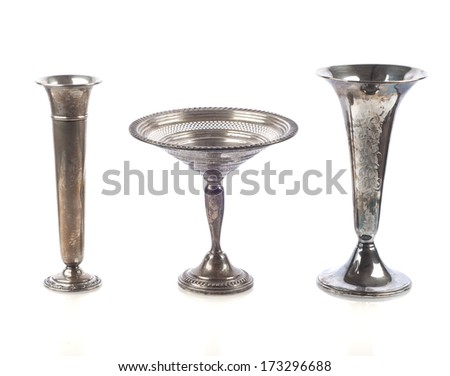 Three Tarnished Silver Vases isolated on white background with a little shadow or reflection  - stock photo