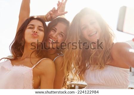 Three Teenage Girls Dancing And Taking Selfie - stock photo